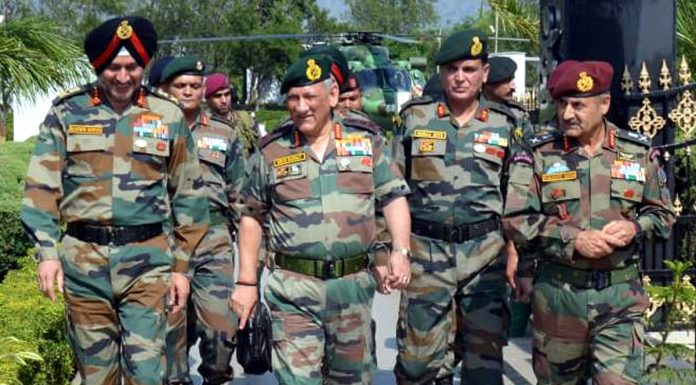 Army chief Gen Bipin Rawat with Northern Command Army Commander Lt Gen Ranbir Singh and GOC White Knight Corps Lt Gen Paramjit Singh in Jammu on Tuesday. (UNI)