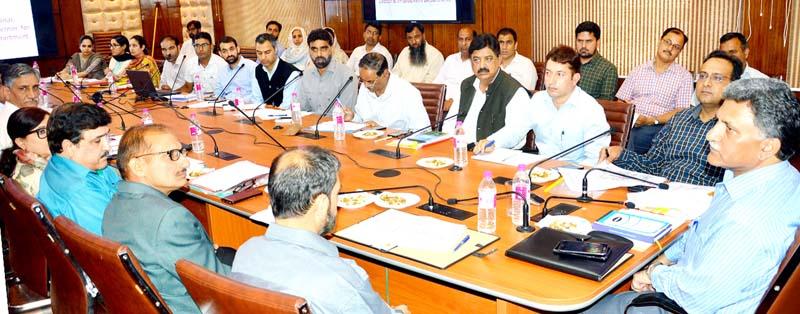 Advisor Khurshid Ahmed Ganai chairing a meeting on Sunday.
