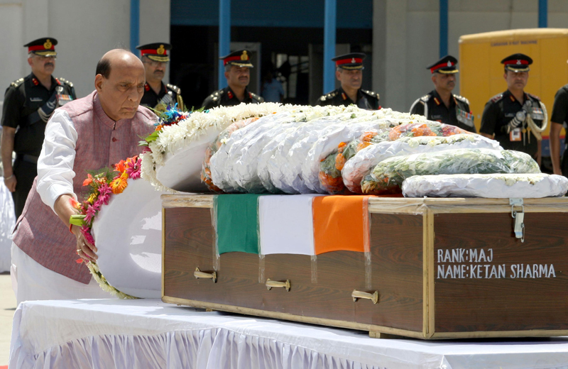 Defence Minister Rajnath Singh laying wreath on the mortal remains of Major Ketan Sharma at Palam Technical Area in New Delhi on Tuesday. (UNI)