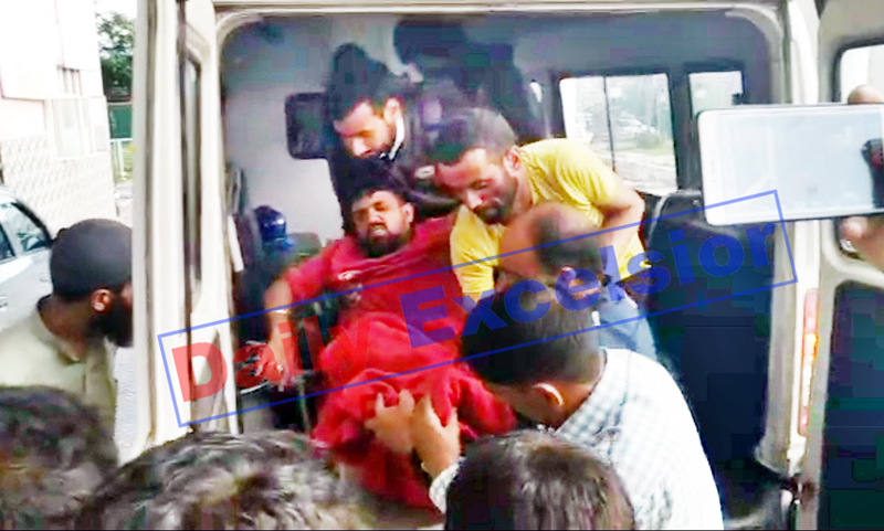A civilian injured in boat capsizing being shifted to hospital in Pahalgam on Tuesday. -Excelsior/Sajjad Dar