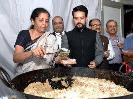 Union Finance Minister Nirmala Sitharaman serving halwa to her colleague Anurag Thakur on Saturday.