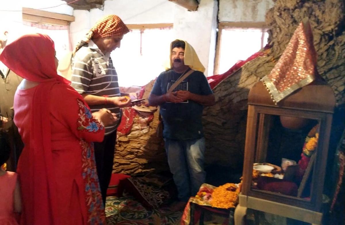 Devotees performing Pooja at the shrine of Mata Roop Bhawani at Safa Kadal, Srinagar.