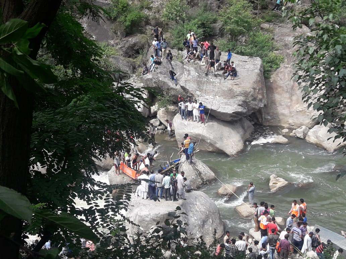 A team of SDRF and locals engaged in rescue operation in Neeru River in Doda district. —Excelsior/Tilak Raj