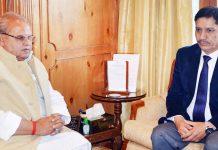 Governor Satya Pal Malik interacting with Chairman J&K Bank R K Chibber at Raj Bhavan Srinagar.