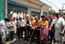 Former Deputy CM, Kavinder Gupta and MLC, Vikram Randhawa kick-starting black topping of road at Model Town on Monday.