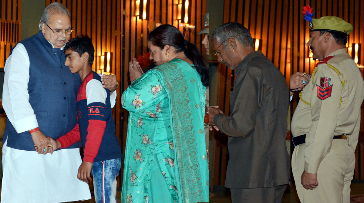 Governor presenting medals to police personnel and next of kin of martyrs on Thursday.
