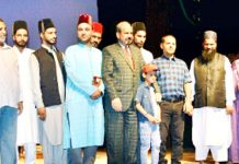 "Dignitaries during release of iconic 'Yumbarzaloo' tourist oriented song and reference book titled ""My Land My Kashmir"" at Srinagar."