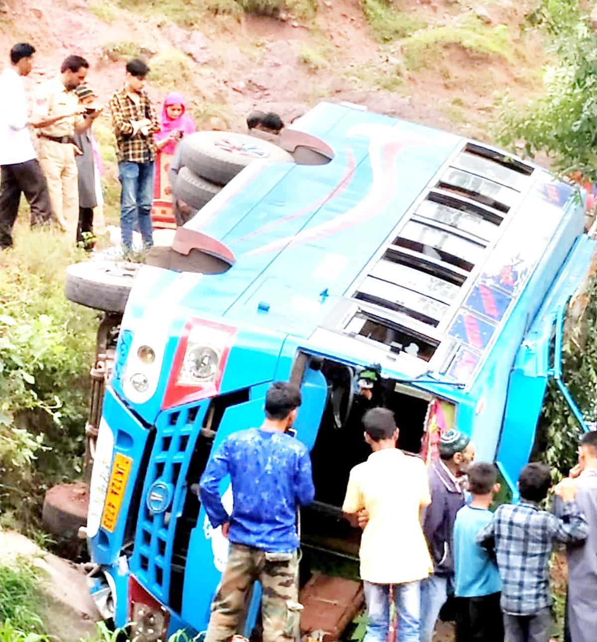 Ill-fated mini-bus which rolled down near Shahpur in Poonch on Monday. -Excelsior/Gurjeet