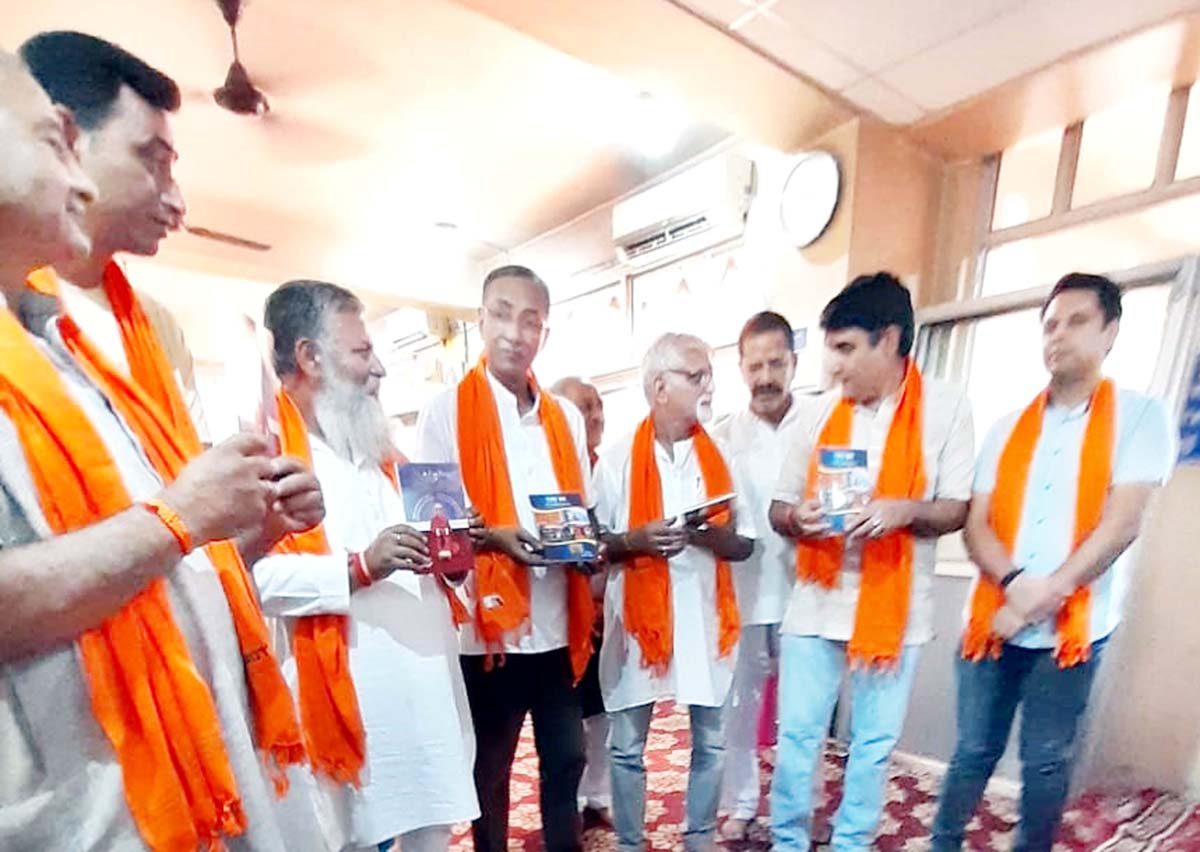 Dr Susheel Wattal, Pradhaan Sewak Bhagwan Ji Ashram along with others releasing a book on Goddess Roop Bhawani at Jammu on Monday.