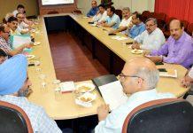 Advisor K K Sharma chairing a meeting at Jammu on Monday.
