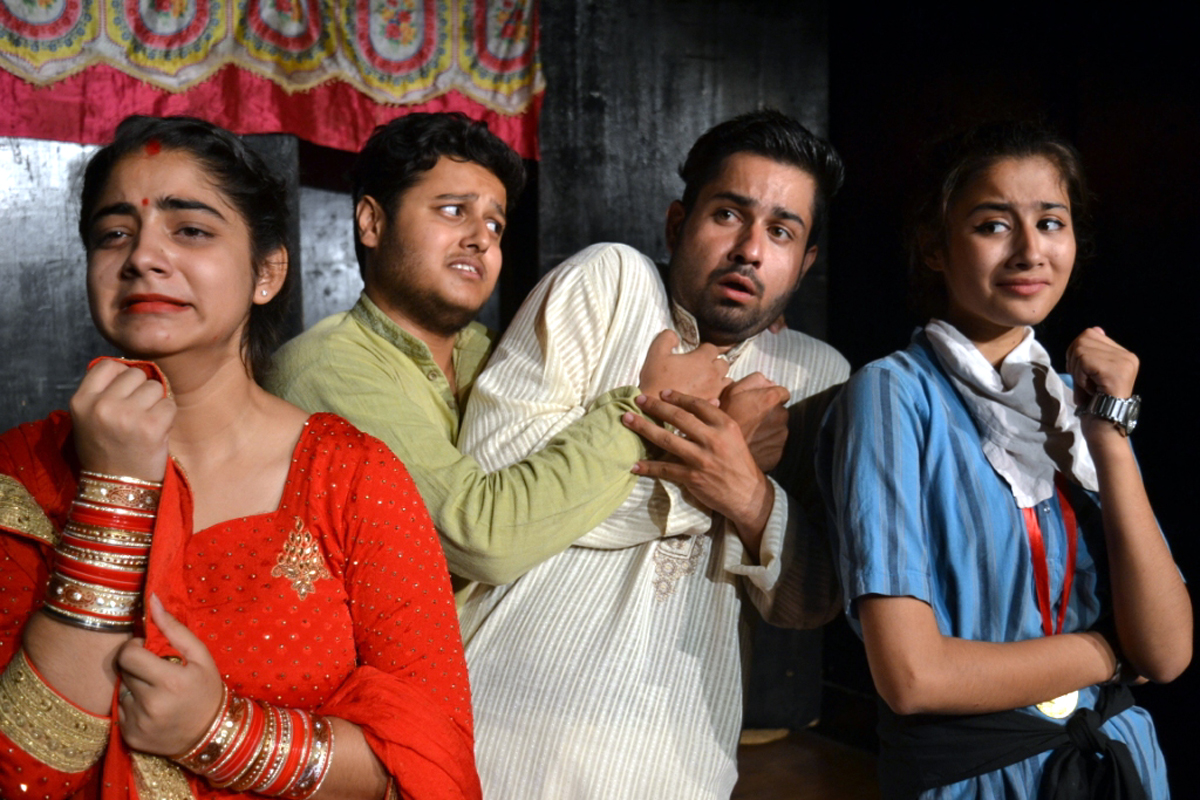 A scene of Hindi play 'Chor' presented by Natrang in Jammu on Sunday.