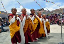 Little nuns performing prayers during tripled blessed occasion of Lord Buddha at Leh. -Excelsior/Morup Stanzin