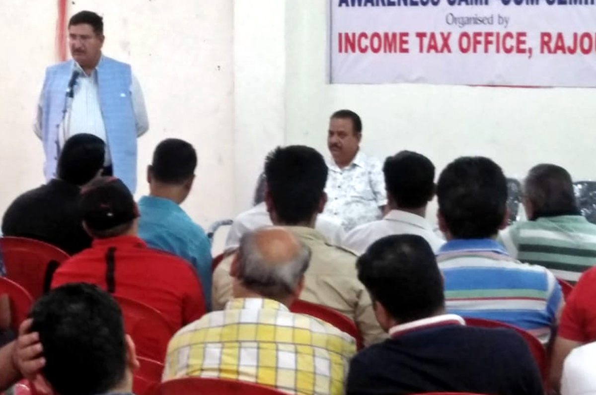 A senior IT officer addressing the participants during a seminar in Rajouri district.