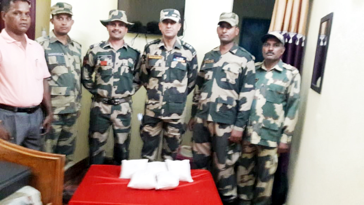 BSF officials showing seized heroin.