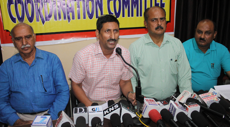 J&K Private Schools Coordination Committee members addressing a press conference at Jammu on Tuesday. -Excelsior/Rakesh