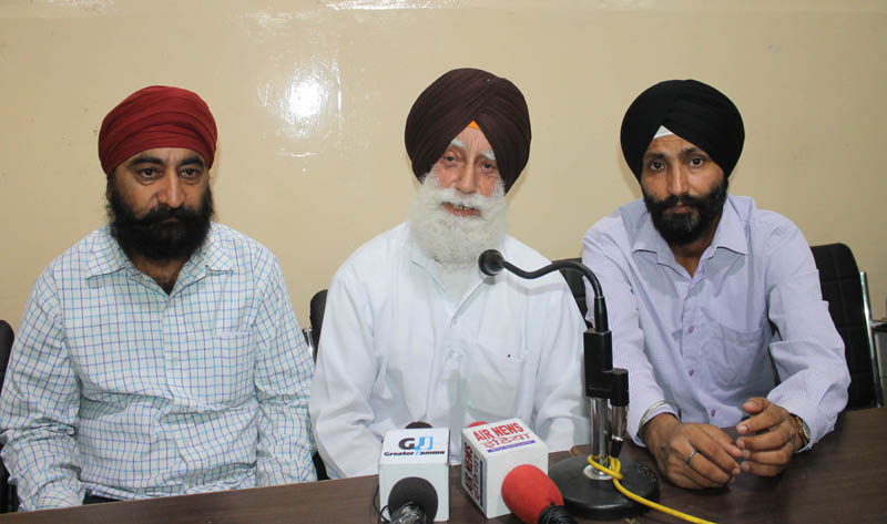 NC leaders from Gole Gujral addressing a press conference at Press Club, Jammu on Tuesday.