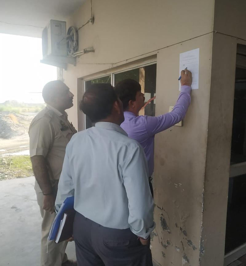 Tehsildar Kathua, Kapil Kant Khajuria sealing an illegal crusher in Kathua on Tuesday. - Excelsior/Pardeep