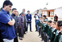 FC Finance Department Arun Mehta interacting with students in Leh on Monday.