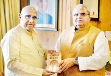 "Avinash Rai Khanna presenting a copy of his book ""Samaj Chintan"" to Governor Satya Pal Malik on Monday."