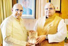 """Avinash Rai Khanna presenting a copy of his book """"Samaj Chintan"""" to Governor Satya Pal Malik on Monday."""