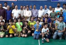 Young shuttlers posing along with dignitaries and officials in Jammu on Monday.