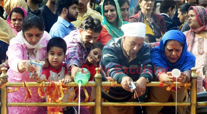 People offering prayers at Kheer Bhawani temple in Ganderbal district on Monday. —Excelsior/Shakeel