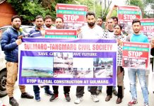 Gulmarg and Tangmarg Civil Society members protesting over illegal constructions in Gulmarg. -Excelsior/Shakeel