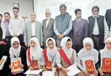 Dignitaries and students posing for group photograph at Kashmir University on Monday.