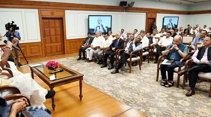 Prime Minister, Narendra Modi interacting with the Secretaries to the Government of India at Lok Kalyan Marg in New Delhi on Monday.