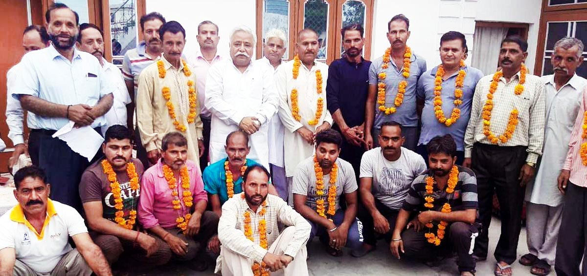 Senior NC leader, Ajay Sadhotra at a meeting in Marh area of district Jammu on Monday.