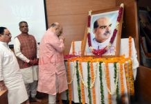 BJP president and Union Home Minister Amit Shah and BJP working president J P Nadda paying floral tributes to Dr S P Mookerjee on his Martyr Day at BJP Headquarters in New Delhi on Sunday. (UNI)