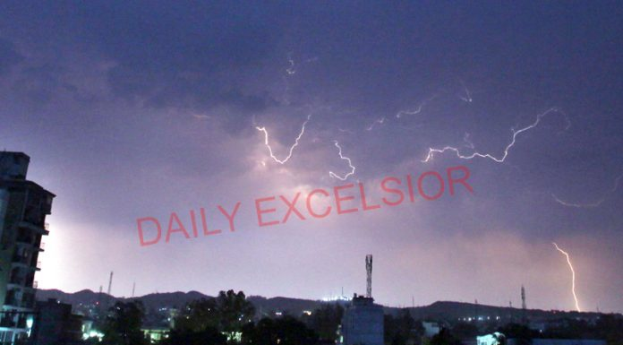 Lightening over Jammu city on late Monday evening. -Excelsior/Rakesh