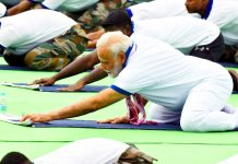Prime Minister Narendra Modi performing Yoga Asana during the 5th International Yoga Day in Ranchi on Friday. (UNI)
