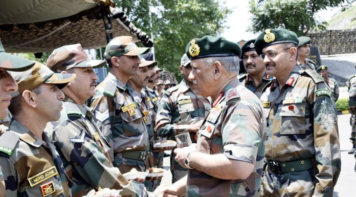 Army chief Gen Bipin Rawat interacting with troops near LoC in Rajouri sector on Friday.
