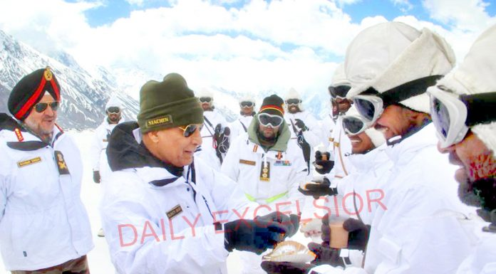Defence Minister Rajnath Singh during inter-action with Army soldiers at Siachen Glacier on Monday.