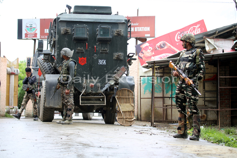 Troops during gunbattle with militants in Sopore on Tuesday.-Excelsior/Aabid Nabi