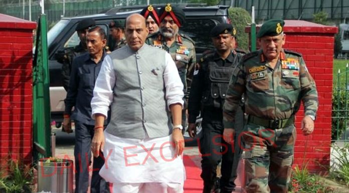 Defence Minister Rajnath Singh and Army chief Gen Bipin Rawat in Srinagar on Monday.