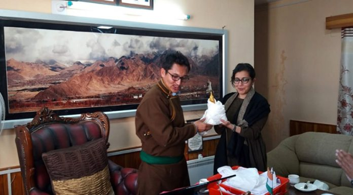 CEC LAHDC Leh J T Namgayal handing over resignation to DC Leh Avny Lavasa in Leh on Friday. -Excelsior/Morup Stanzin