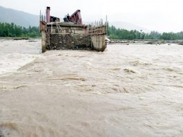 Achthal village in South Kashmir's Kulgam district was disconnected due to flash floods in Nalla Veshow on Wednesday. —Excelsior/Sajjad Dar