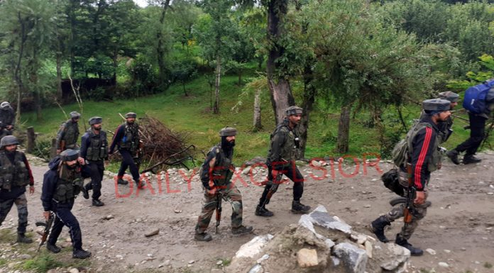 Troops head towards the site of encounter at Keegam, Shopian on Sunday. -Excelsior/Younis Khaliq