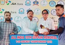 Winner receiving man of the match award from dignitaries at Sports Stadium Doda.