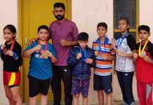 Medal winners of State Pencak Silat with coach at Jammu.