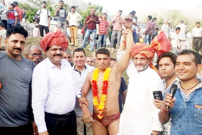 Winner of 17th Karua Dangal Title being felicitated by the chief guest and other dignitaries on Monday.