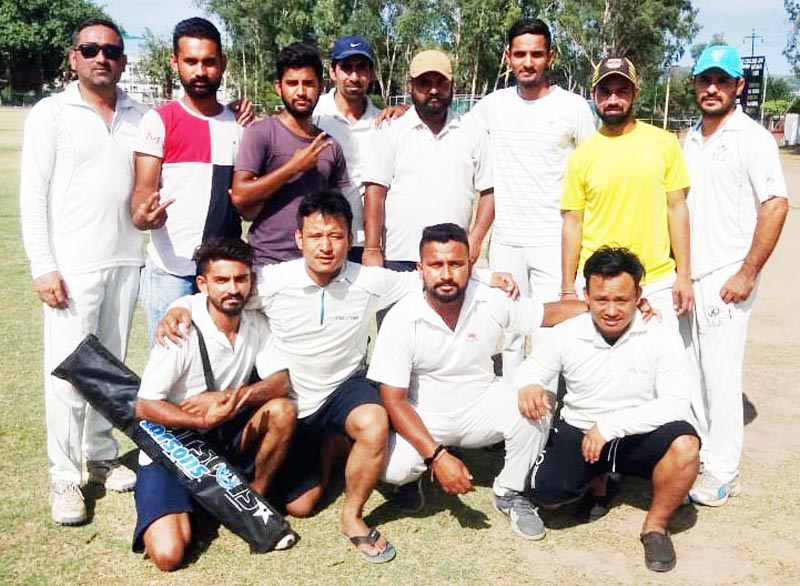 Gorkha CC players posing for a group photograph after registering win over Bhatia CA in Jammu on Sunday.