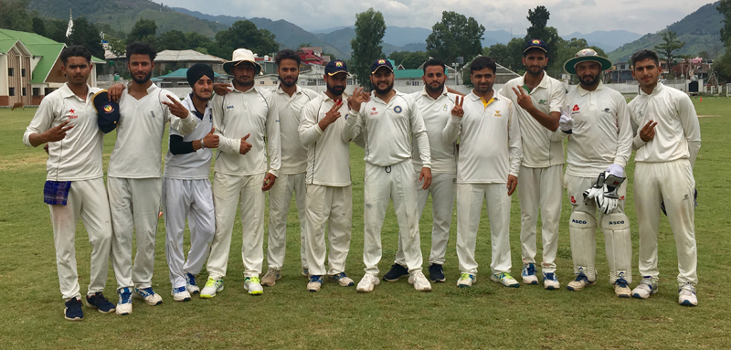 Winners Haveli XI posing for a group photograph after registering win at Sports Stadium, Poonch on Monday.