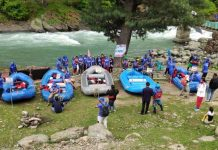 Rafters ready to go during Rouf Memorial Rafting Championship in Pahalgam on Monday.