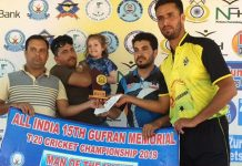 Ashraf Rather receiving man of the match award after taking all 10 wickets in a match of Gufran T20 on Monday.