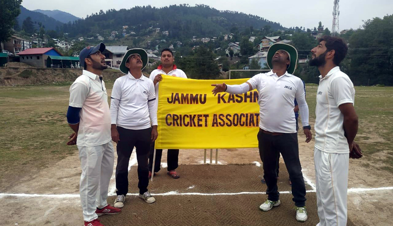 Toss of coin being held during a match of JKCA Tournament at Bhaderwah.