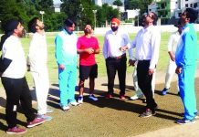 Toss of coin being held during T20 match at Sports Stadium in Poonch.