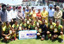 Winners of Inaugural 7-A-Side Women's Hockey Tournament-2019 posing along with dignitaries in Srinagar on Monday.